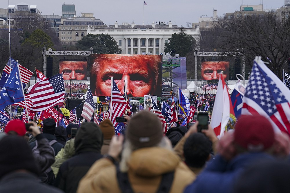 Trump supporters participate in a rally Wednesday, Jan. 6, 2021 in Washington. As Congress prepared to affirm President-elect Joe Biden's victory, thousands gathered to show their support for President Donald Trump and his baseless claims of election fraud.  (AP Photo/John Minchillo)