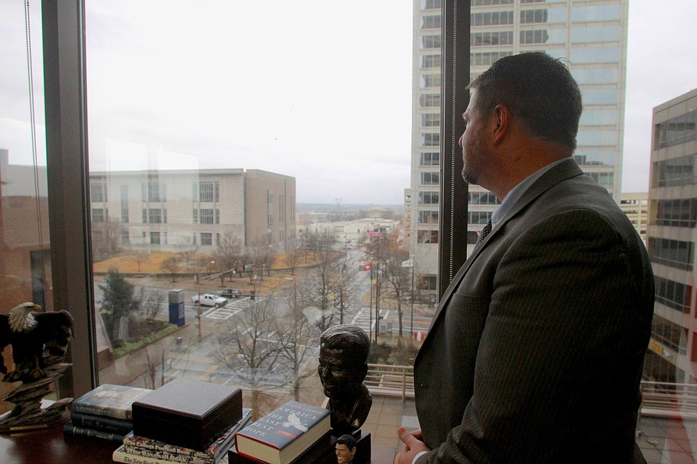 Acting U.S. Attorney Jonathan Ross looks out at the U.S. Federal Courthouse from his vantage point on the 5th floor of the Simmons Bank Tower in downtown Little Rock. Ross was appointed to the position, which he will hold until a new U.S. attorney for the Eastern District of Arkansas is appointed, following the resignation of former U.S. Attorney Cody Hiland. (Arkansas Democrat-Gazette/Dale Ellis)
