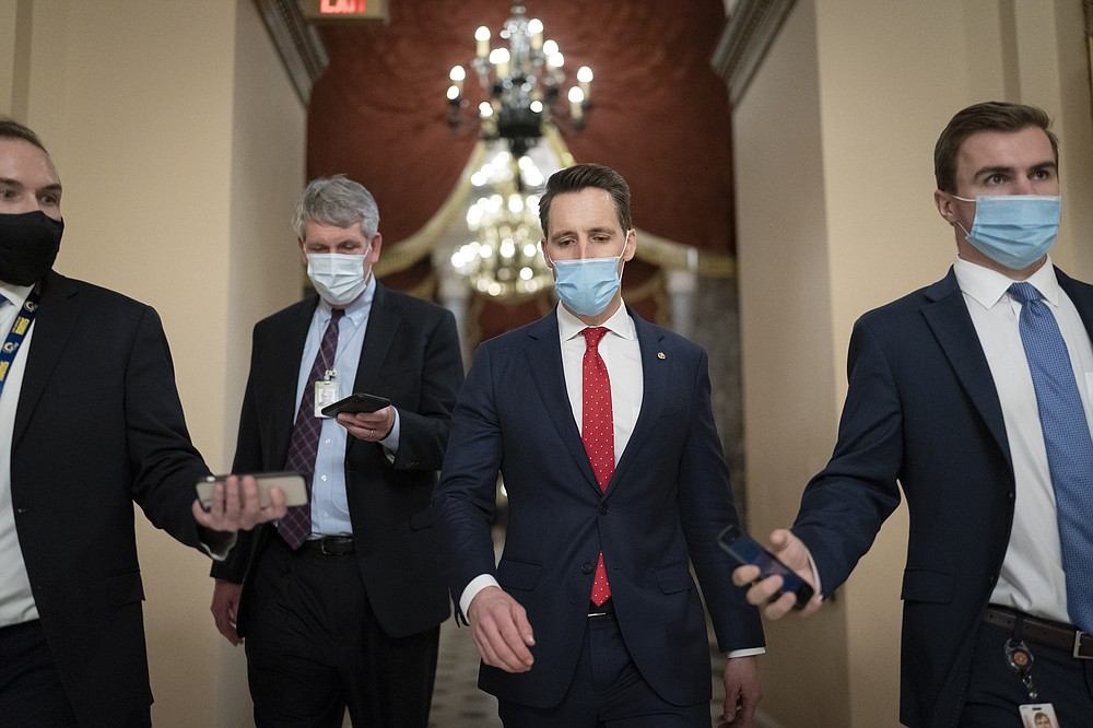 After violent protesters loyal to President Donald Trump stormed the U.S. Capitol today, Sen. Josh Hawley, R-Mo., walks to the House chamber to challenge the results of the presidential election in Pennsylvania during the joint session of the House and Senate to count the Electoral College votes cast in November's election, at the Capitol in Washington, Wednesday, Jan. 6, 2021. (AP Photo/J. Scott Applewhite)