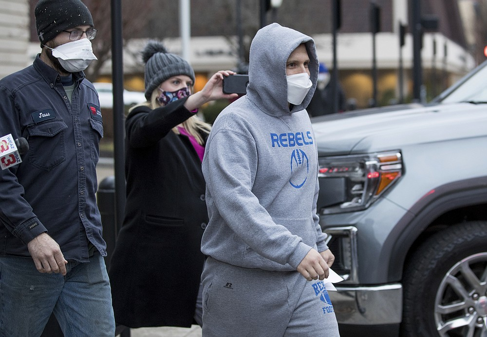 West Virginia Delegate Derrick Evans exits the Sidney L. Christie U.S. Courthouse and Federal Building after being arraigned on federal charges Friday, Jan. 8, 2021, in Huntington, W.Va. Evans, a West Virginia state lawmaker who posted videos online showing himself pushing his way inside the Capitol, was arrested Friday by the FBI at his home and charged with entering restricted federal property. Evans, who faced bipartisan calls for him to step down, submitted a letter of resignation Saturday, Jan. 9, 2021 to West Virginia Gov. Jim Justice and apologized for his actions. (Sholten Singer/The Herald-Dispatch via AP)