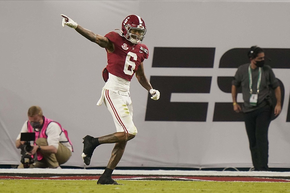 Alabama wide receiver DeVonta Smith celebrates after scoring against Ohio State during the first half of an NCAA College Football Playoff national championship game, Monday, Jan. 11, 2021, in Miami Gardens, Fla. (AP Photo/Lynne Sladky)