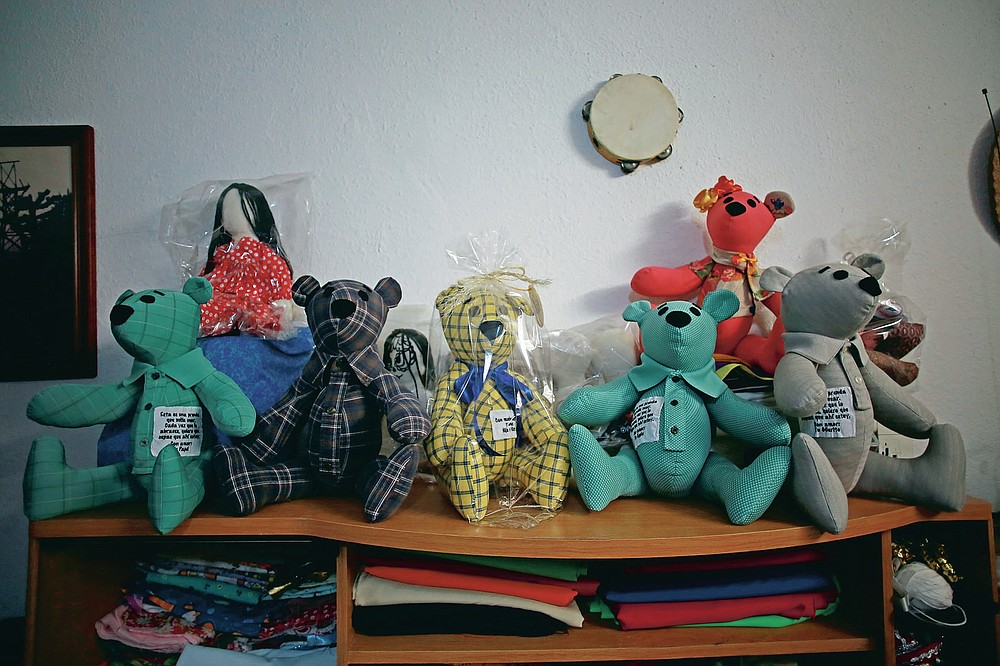 """Stuffed bears ready for delivery sit in the home workshop of Erendira Guerrero, who has been making the bears for people who lost a family member to COVID-19 using one of the deceased's articles of clothing, in Ciudad Juarez, Mexico, Monday, Jan. 11, 2021. """"Due to COVID-19, many people were left without closure, because they couldn't say goodbye to their family members. They need to close the circle. The bears are helping them,"""" said Guerrero. (AP Photo/Christian Chavez)"""