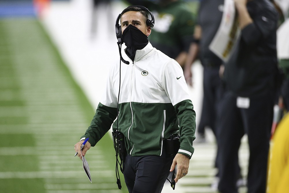 FILE - In this Dec. 13, 2020, file photo, Green Bay Packers coach Matt LaFleur looks to the scoreboard during the first half of the team's NFL football game against the Detroit Lions in Detroit. LaFleur was the Los Angeles Rams' offensive coordinator in 2017 during the first year of Sean McVay's head coaching tenure after they spent four seasons working together on Mike Shanahan's Washington staff. The Packers and the Rams meet in in a playoff game this weekend. (AP Photo/Leon Halip, File)