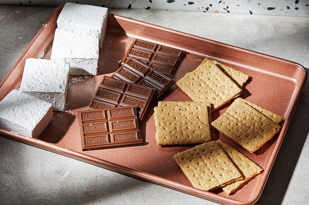 The classic s'more ingredients include marshmallows, milk chocolate and graham crackers. (For The Washington Post/Tom McCorkle)