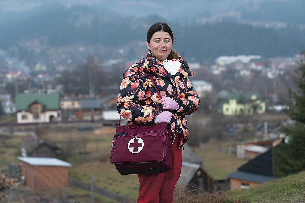 Dr. Viktoria Mahnych, poses for a photo prior to her interview with the Associated Press in Verhovyna village, Ivano-Frankivsk region of Western Ukraine, Wednesday, Jan. 6, 2021. Mahnych fears that a lockdown in Ukraine came too late and the long holidays, during which Ukrainians frequented entertainment venues, attended festive parties and crowded church services, will trigger a surge in new coronavirus infections. (AP Photo/Evgeniy Maloletka)