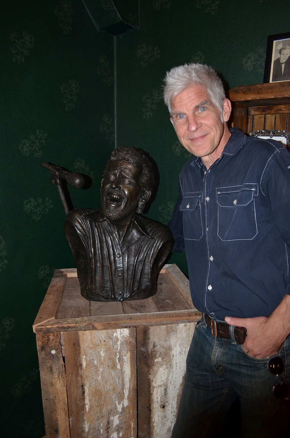 Little Rock sculptor Kevin Kresse stands beside his Levon Helm bronze bust on display at the Levon Helm Memorial Park at Marvell. (Special to The Commercial)
