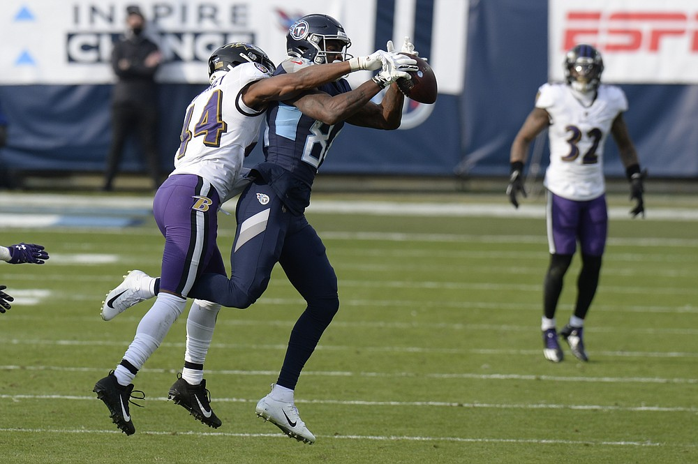 Baltimore Ravens cornerback Marlon Humphrey (44) breaks up a pass intended for Tennessee Titans wide receiver Corey Davis (84) in the second half of an NFL wild-card playoff football game Sunday, Jan. 10, 2021, in Nashville, Tenn. (AP Photo/Mark Zaleski)