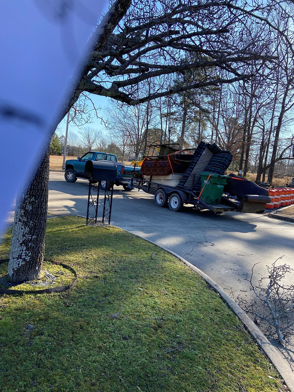 A truck and trailer are filled with debris and other furniture picked up Saturday morning as part of the cleanup. (Special to The Commercial/Deborah Horn)