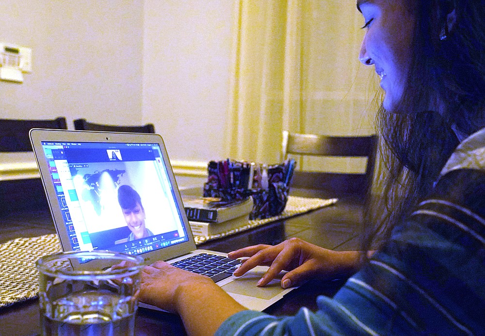 Charvi Goyal, 17, gives an online math tutoring session to a junior high student Monday, Jan. 4, 2021, in Plano, Texas. Goyal is part of a group of high school students that put together their own volunteer online tutoring service to help k-12 during the pandemic. (AP Photo/LM Otero)