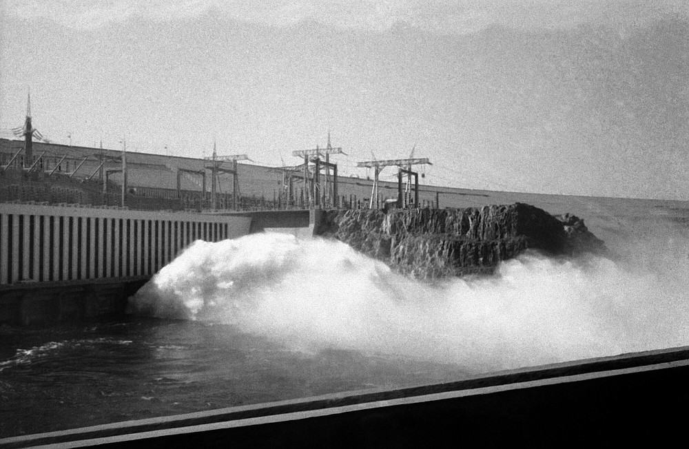 HOLD FILE - In this Jan. 15, 1971 file photo, water flows into the Aswan high dam after the inauguration ceremony in Aswan, Egypt.  Egyptians are marking 50 years since the inauguration of the Nile dam, a massive feat of construction that has shaped the course of modern-day Egypt. It spared it from seasonal droughts and flooding, and generated electricity. (AP Photo, File)