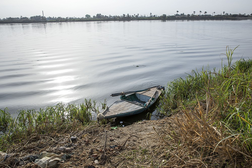 A boat is moored on the Nile river in Atfih town, Giza, Egypt, Tuesday, Jan. 12, 2021. Egyptians are marking 50 years since the inauguration of the Aswan High Dam, a massive feat of construction that has shaped the course of modern-day Egypt. It spared it from seasonal droughts and flooding, and generated electricity, but it also displaced members of the country's Nubian minority and had a lasting environmental impact on the region. (AP Photo/Nariman El-Mofty)