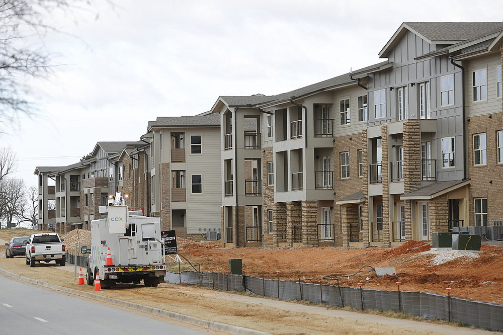 The construction of a 468-unit apartment community is visible Thursday, January 14, 2021, near Arvest Ballpark in Springdale. The apartments are called the Trails at the Crossings. Check out nwaonline.com/210117Daily/ and nwadg.com/photos for a photo gallery. (NWA Democrat-Gazette/David Gottschalk)