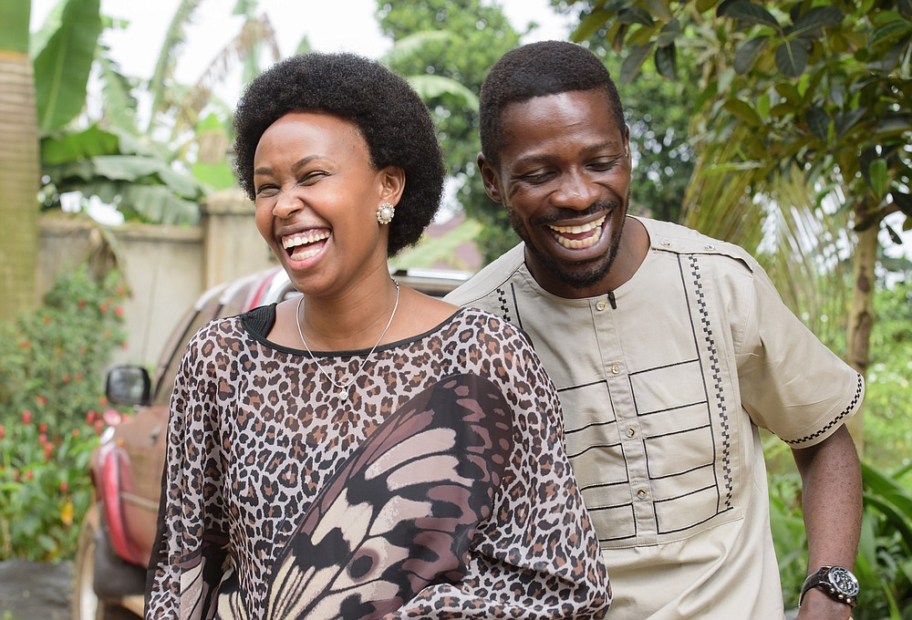 Uganda's leading opposition challenger Bobi Wine, right, and his wife Barbie Kyagulanyi, in cheerful mood after casting their votes in Kampala, Uganda, Thursday, Jan. 14, 2021. Ugandans are voting in a presidential election tainted by widespread violence that some fear could escalate as security forces try to stop supporters of Wine from monitoring polling stations.(AP Photo/Nicholas Bamulanzeki)