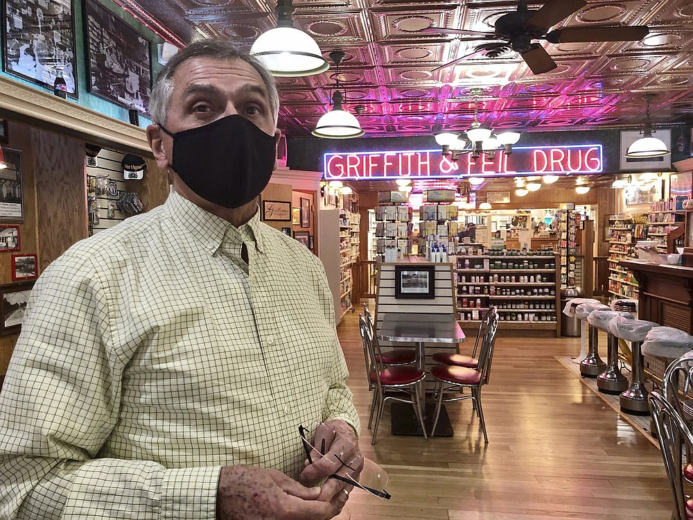 Pharmacist Ric Griffith stands in his family's business Friday, Jan. 15, 2021, in Kenova, W.Va. Griffith & Feil is among 250 mom-and-pop pharmacies in West Virginia helping to vaccinate residents in the quest to banish the coronavirus pandemic. (AP Photo/John Raby)