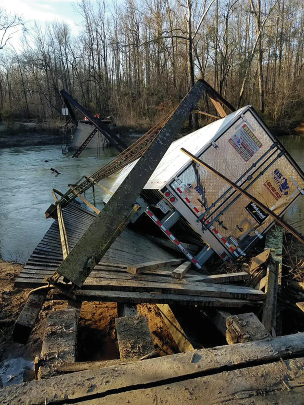 State sues over destroyed bridge