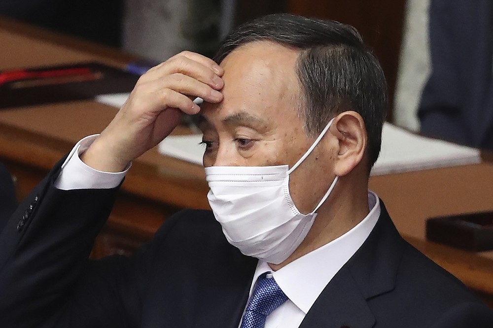 Japanese Prime Minister Yoshihide Suga attends an ordinary Diet session at the upper house of parliament in Tokyo, Monday, Jan. 18, 2021. (AP Photo/Koji Sasahara)