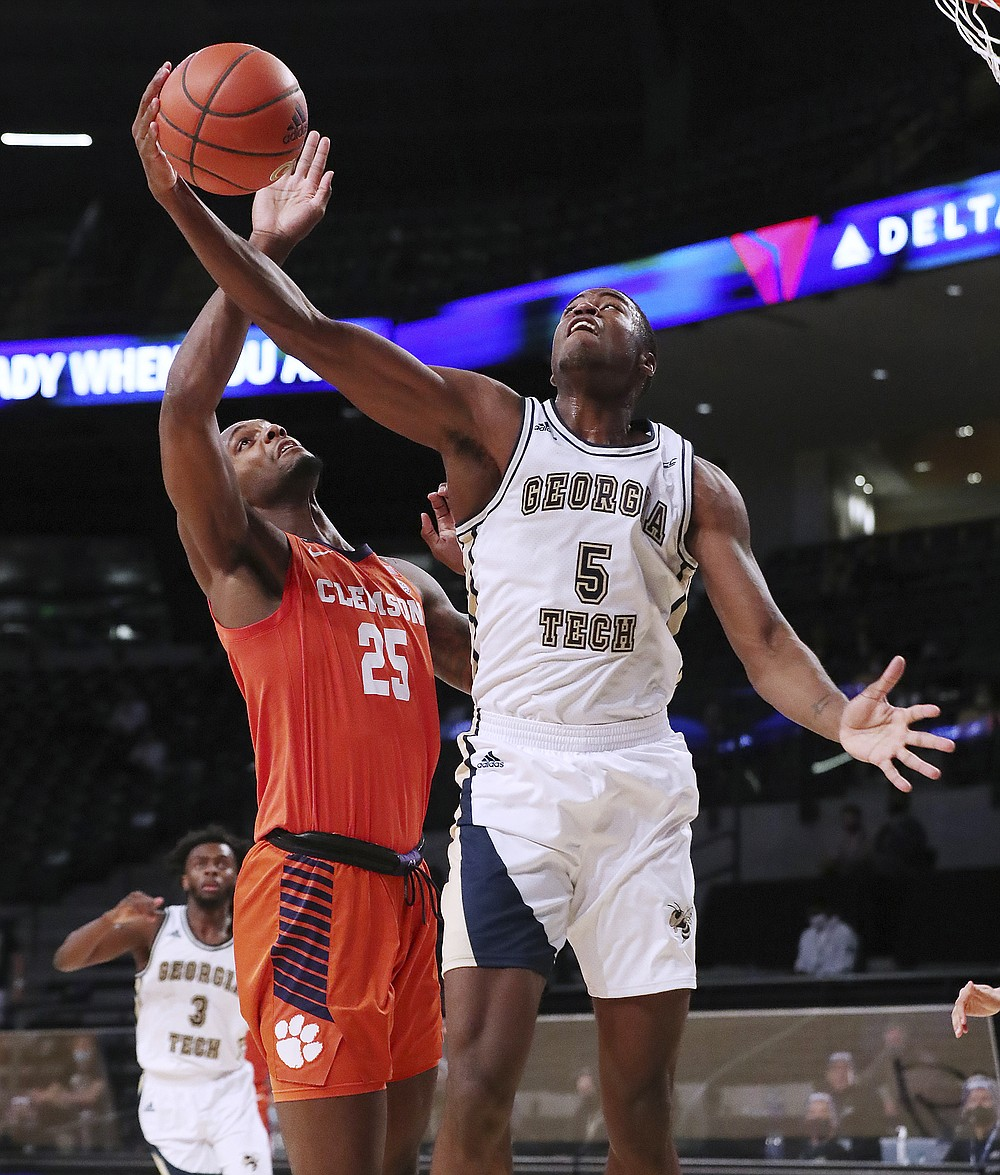 Georgia Tech forward Moses Wright, right, grabs a rebound against Clemson forward Aamir Simms during the first half of an NCAA college basketball game Wednesday, Jan. 20, 2021, in Atlanta. (Curtis Compton/Atlanta Journal Constitution via AP, Pool)