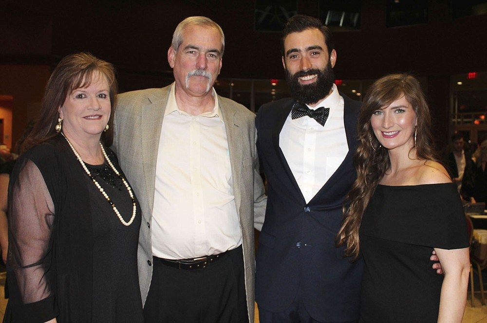 NWA Democrat-Gazette/CARIN SCHOPPMEYER Jill and Steve Mitchael(cq), All In 2018 honorary chairmen (from left) and Jake and Betsy Mitchael enjoy the benefit for Teen Action Support Center on Feb. 2 at the Hammons Center.