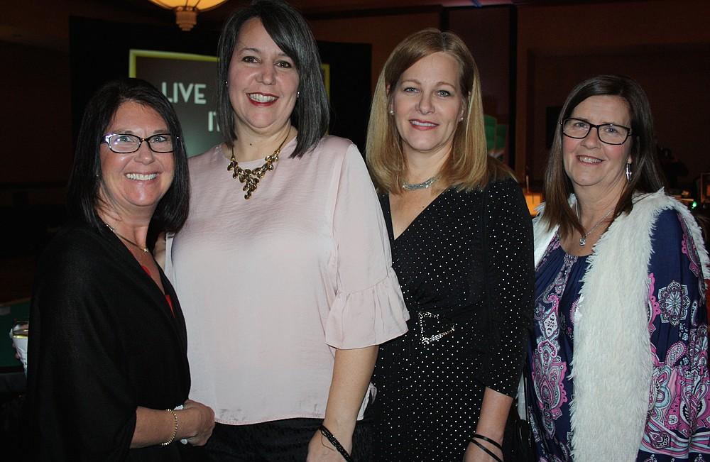 NWA Democrat-Gazette/CARIN SCHOPPMEYER Michele Lisownki (from left), Ashley Vaughan, Sharon Lloyd and Susan Hart attend All in for TASC.