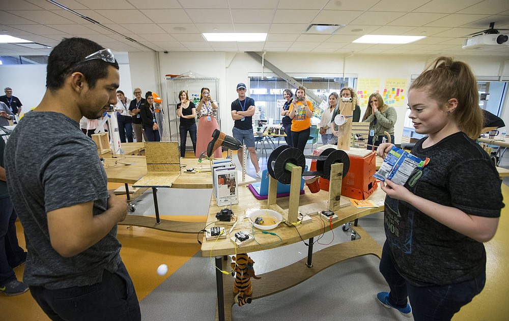 NWA Democrat-Gazette/BEN GOFF @NWABENGOFF Maximiliano Perez, who works with Teen Action and Support Center and volunteers with Stitches in Springdale, and Hayley Chronister, an educator at Mid-America Science Museum in Hot Springs, help get a chain reaction machine working Friday, June 7, 2019, during the Maker Boot Camp for educators at the Scott Family Amazeum in Bentonville. Educators from Northwest Arkansas and beyond spent four days learning hands-on ways to use making and tinkering in their classrooms to facilitate creative thinking, problem solving and collaboration. Participants built the Rube Goldberg style chain reaction machine as the conclusion of the camp.