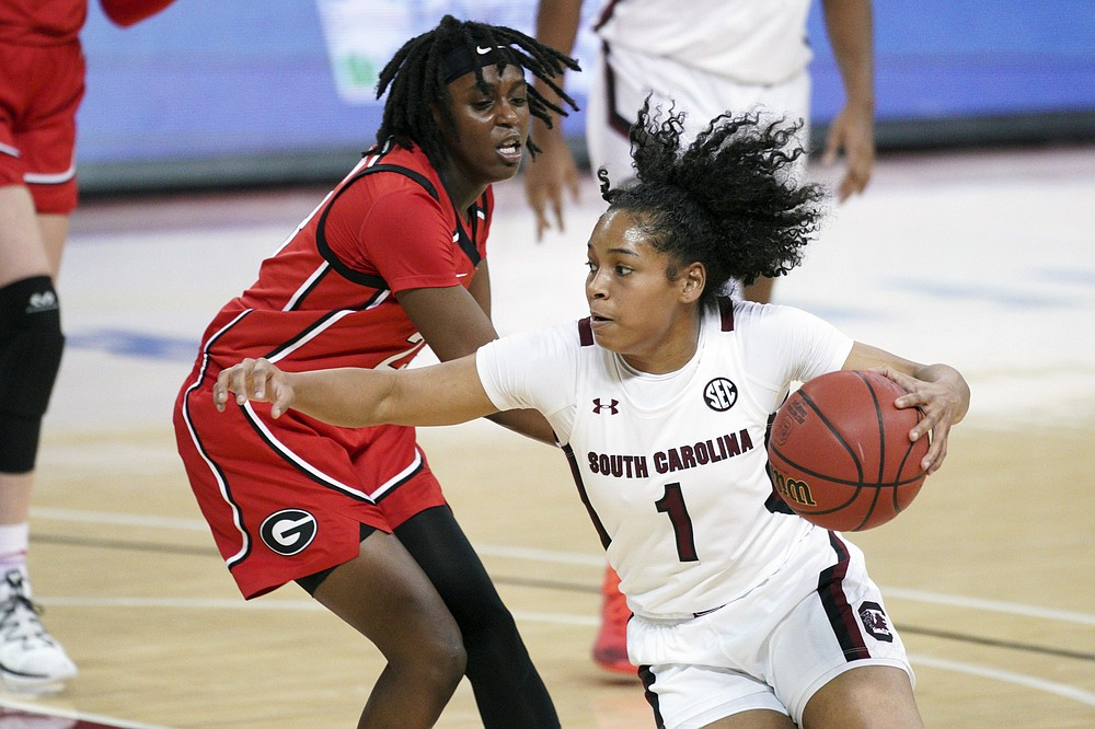 South Carolina guard Zia Cooke (1) dribbles against Georgia guard Que Morrison (23) during the first half of an NCAA college basketball game Thursday, Jan. 21, 2021, in Columbia, S.C. (AP Photo/Sean Rayford)
