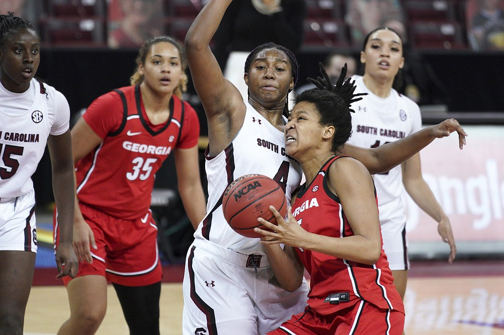Georgia center Maori Davenport drives to the basket against South Carolina forward Aliyah Boston (4) during the second half of an NCAA college basketball game Thursday, Jan. 21, 2021, in Columbia, S.C. (AP Photo/Sean Rayford)