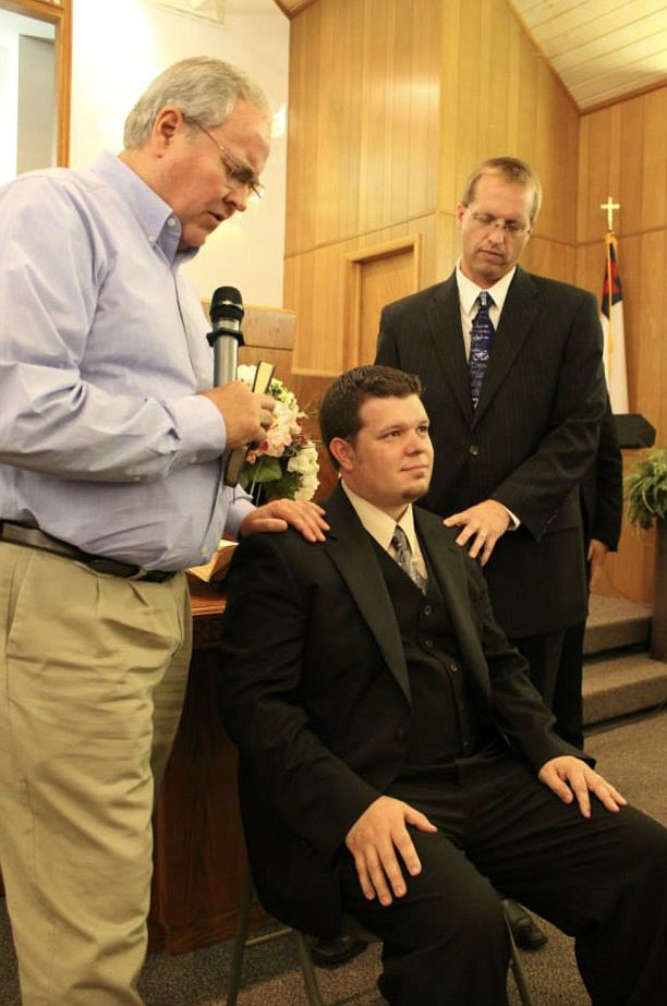 Barry Smith (left), former pastor of Farmington First Baptist Church, and Guy Durkee (right), a pastor at Oak Grove Baptist Church in Springdale, ordain James Bryan (middle) into Bethel Deaf Fellowship in 2014. Bryan has been a pastor for the fellowship for six years.  (Courtesy Photo/Bethel Deaf Fellowship)