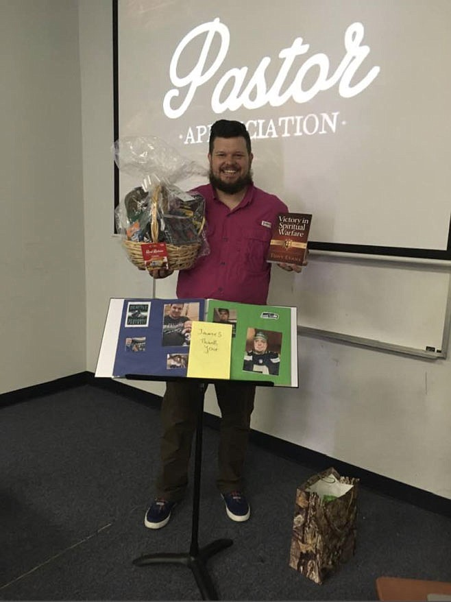 James Bryan receives gifts from his congregation to show they appreciate him as a pastor.  (Courtesy Photo/Bethel Deaf Fellowship)
