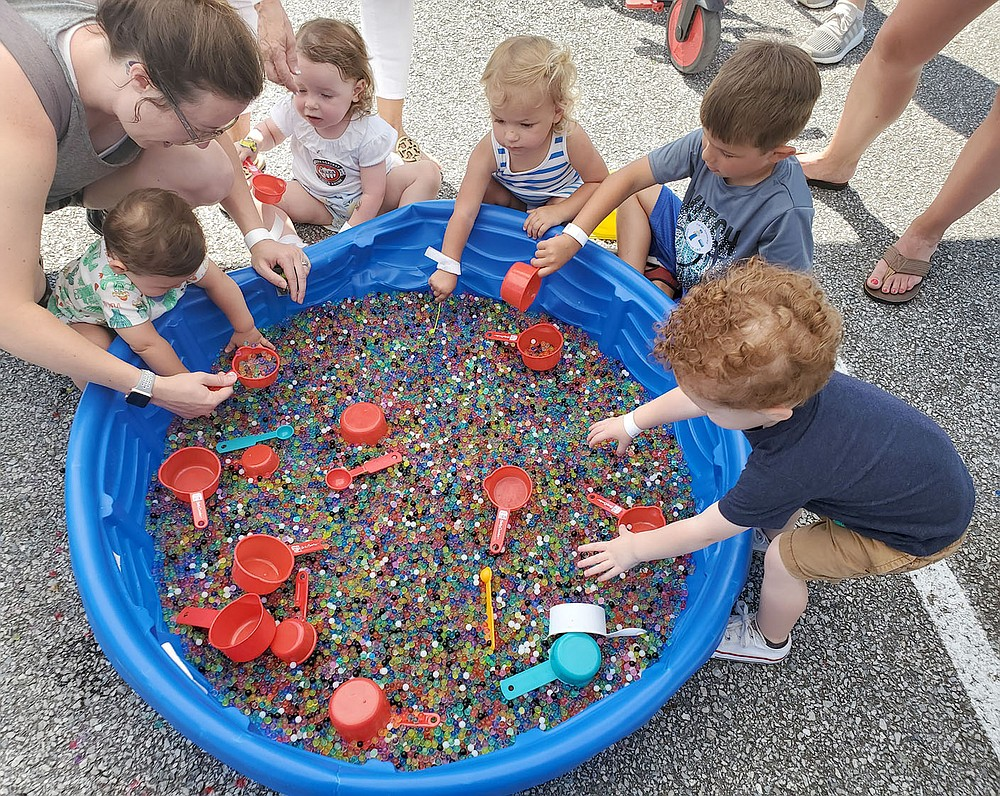 COURTESY PHOTO Children play with water beads at a Macraroni Kids booth during an event in Northwest Arkansas. Kara Ault of Prairie Grove is the publisher for two Macaroni Kids websites, one for Fayetteville and one for Rogers-Bentonville.