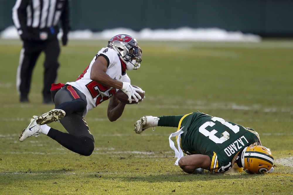 Tampa Bay Buccaneers' Sean Murphy-Bunting intercepts a pass intended for Green Bay Packers' Allen Lazard during the first half of the NFC championship NFL football game in Green Bay, Wis., Sunday, Jan. 24, 2021. (AP Photo/Matt Ludtke)