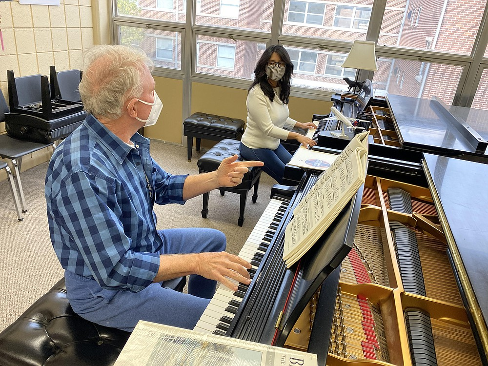 Neil Rutman, Klipsch artist in residence with the University of Central Arkansas music department, instructs Carolina Segales, a junior from La Paz, Bolivia, in January. With precautions, Rutman has continued in-person piano lessons during the pandemic.  (Special to the Democrat-Gazette/Cesar Blas)