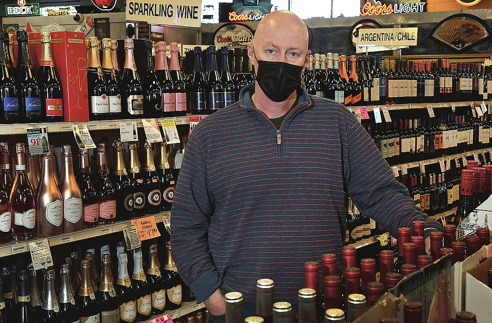 Jim Archibald, who has owned Morgans Liquor for 20 years, will be shown at his store in southeast Denver on Monday, January 11, 2021.  Archibald said selling full-strength beer in grocery stores had an impact on his profits, especially since he shares a parking lot with a Safeway store.  (Kathryn Scott / The Colorado Sun via AP)