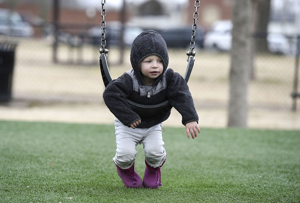 Penelope Portwood, 2, swings,†Friday, January 15, 2021 at Dave Peel Park in Bentonville. Bentonville is looking at a $266 million bond project for street and park improvements as well as other capital projects in the city.  (NWA Democrat-Gazette/Charlie Kaijo)