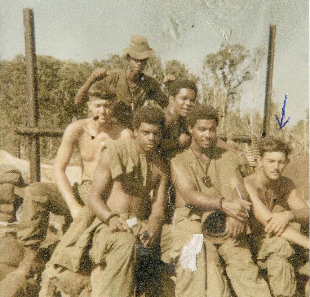 COURTESY PHOTO Calvin Chambers is pictured front, right in this photo from when he served with the U.S. Army.