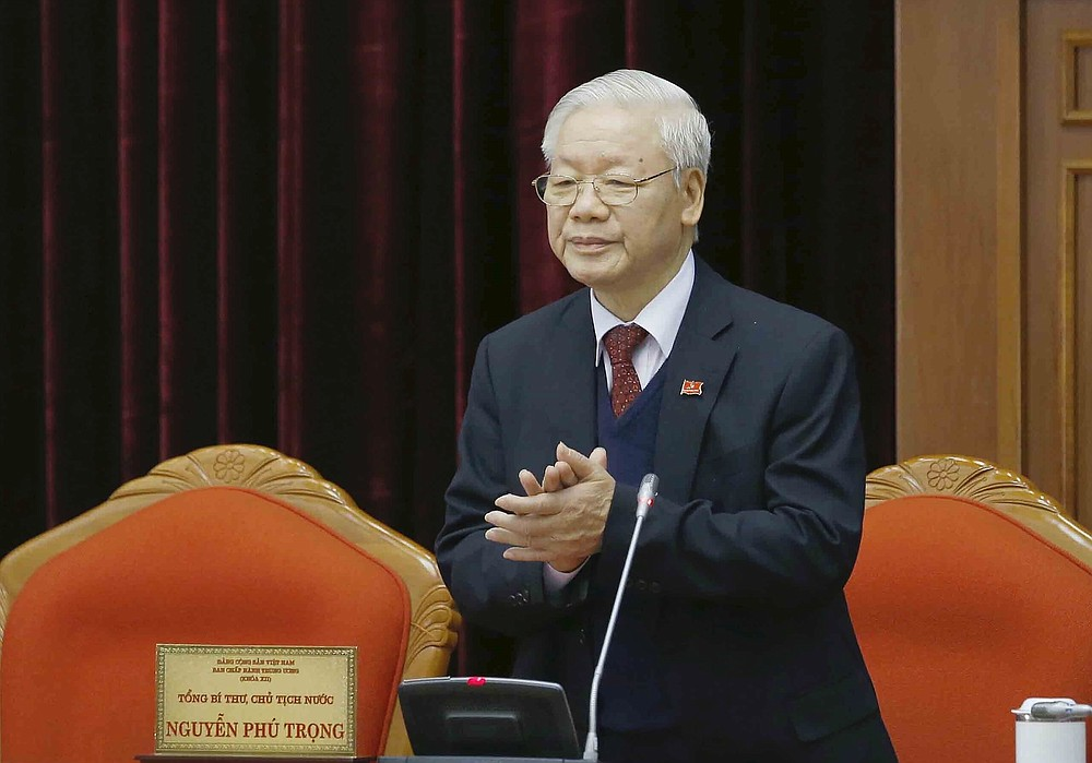 Vietnam Communist party General Secretary Nguyen Phu Trong applauds during a party meeting in Hanoi, Vietnam, Sunday, Jan. 31, 2021. Vietnam Communist Party has re-elected Nguyen Phu Trong for another term as the party's General Secretary, the country de-facto top leader. (Le Tri Dung/VNA via AP)