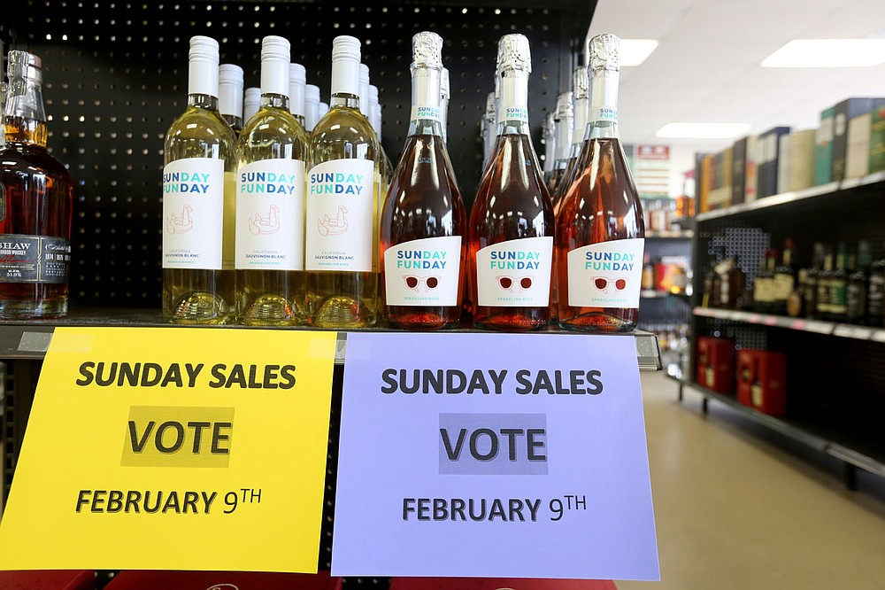 Signage was posted, prior to the election, inside C and J Liquor, located at 129 Fowler St., Suite A, in Gentry. A special election on Feb. 9 determined whether to authorize the sale of alcoholic beverages for off-premises consumption on Sundays between the hours of 10 a.m. and midnight within the city of Gentry. The City Council on Sept. 8 voted to add the ballot initiative to the Nov. 3 general election following a petition by Charles and Jerah Jech to have the initiative added to the ballot. The measure was submitted too late for the Nov. 3 ballot and was moved to December. When that date would not work, the election was scheduled for Feb. 9. (NWA Democrat-Gazette/David Gottschalk)