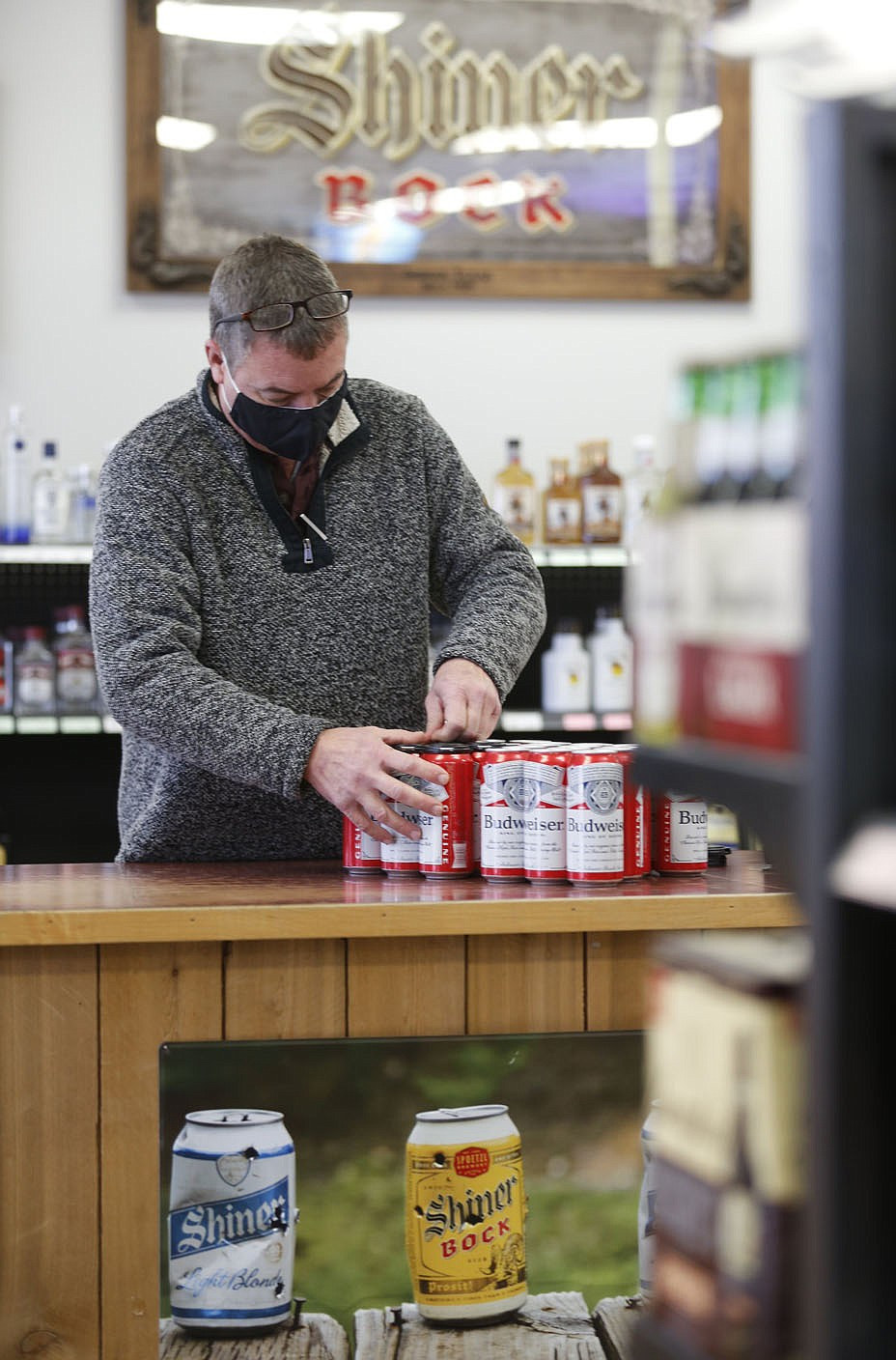 Charles Jech builds Tuesday, January 26, 2021, six packs of beer inside C and J Liquor located at 129 Fowler St., Suite A in Gentry. A special election on Feb. 9 will determine whether to authorize the sale of alcoholic beverages for off-premises consumption on Sundays between the hours of 10 a.m. and midnight within the city of Gentry. The City Council on Sept. 8 voted to add the ballot initiative to the Nov. 3 general election following a petition by Charles and Jerah Jech to have the initiative added to the ballot. The measure was submitted too late for the Nov. 3 ballot and was moved to December. When that wouldn't work, the election was scheduled for Feb. 9. Check out nwadg.com/photos for a photo gallery. (NWA Democrat-Gazette/David Gottschalk)