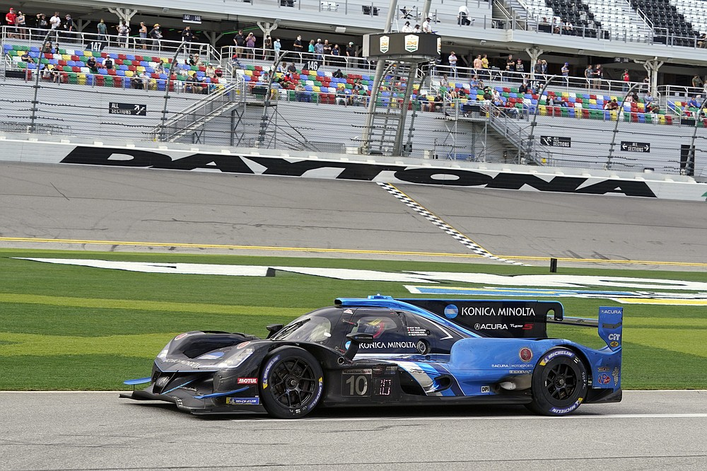 Filipe Albuquerque drives his Acura DPi out pit road to the track after his last pit stop in the Rolex 24 hour auto race at Daytona International Speedway, Sunday, Jan. 31, 2021, in Daytona Beach, Fla. (AP Photo/John Raoux)