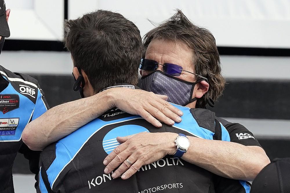 Team owner Wayne Taylor, right, hugs his son Ricky after winning the Rolex 24 hour auto race at Daytona International Speedway, Sunday, Jan. 31, 2021, in Daytona Beach, Fla. (AP Photo/John Raoux)