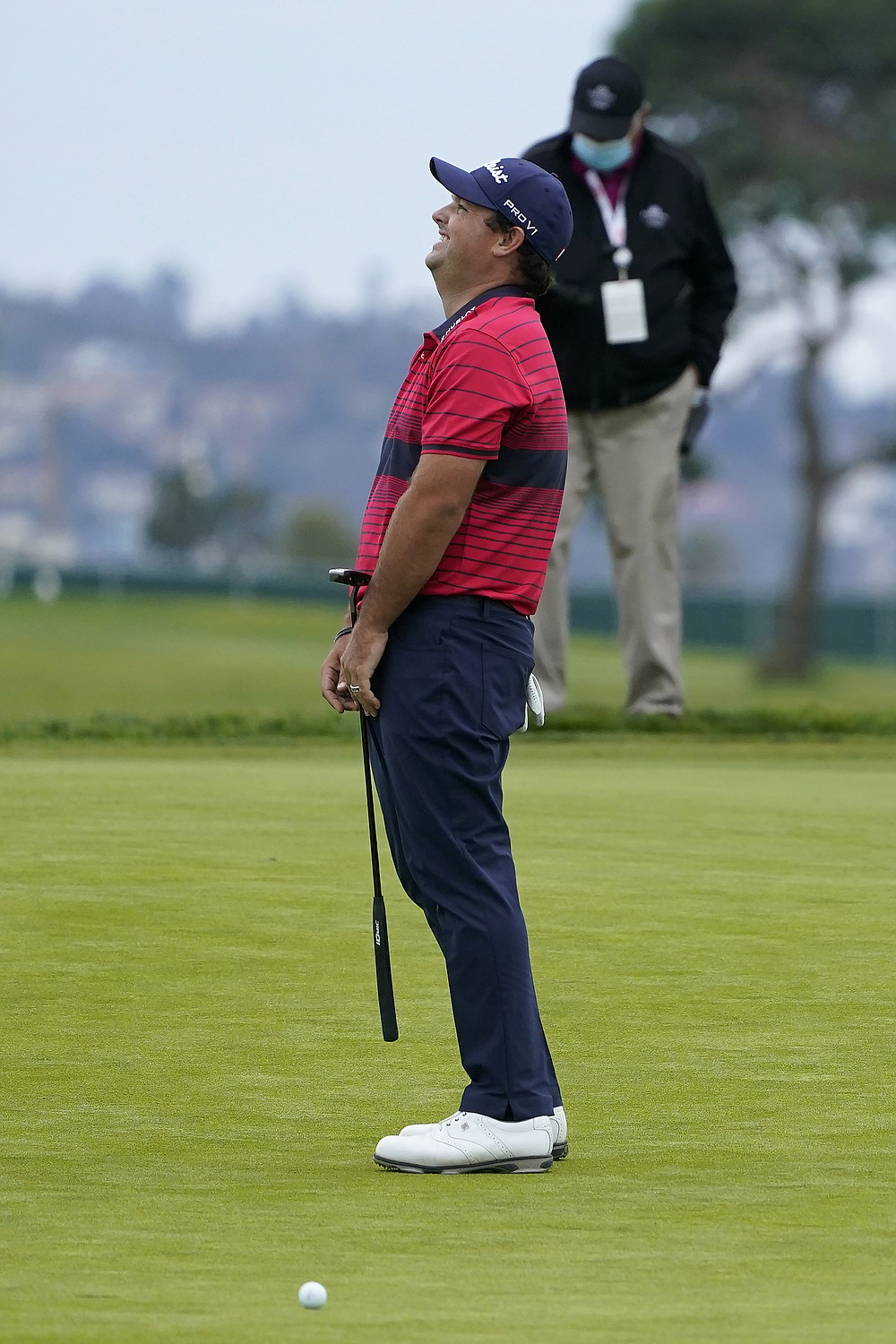Patrick Reed reacts after missing a putt on the 16th hole on the South Course during the final round of the Farmers Insurance Open golf tournament at Torrey Pines, Sunday, Jan. 31, 2021, in San Diego. (AP Photo/Gregory Bull)