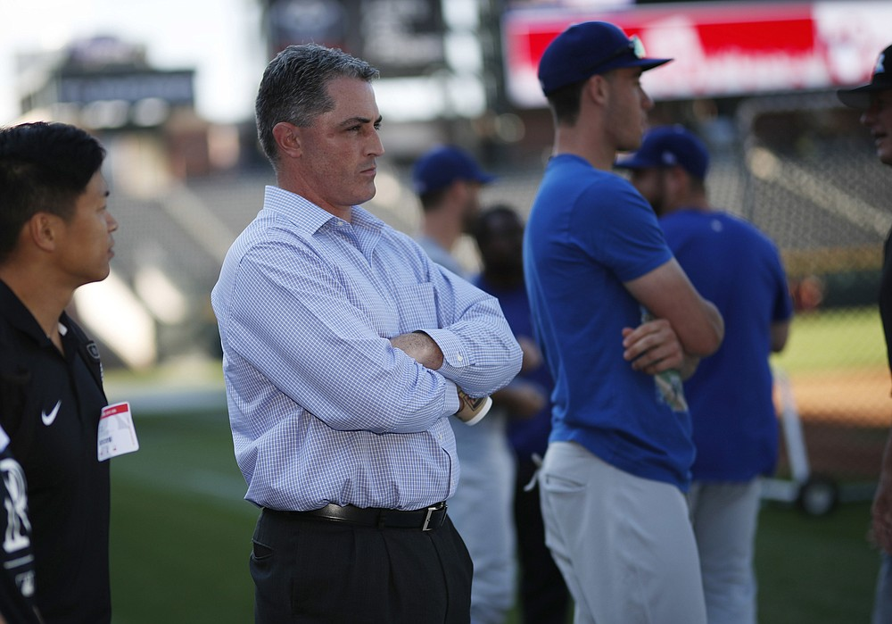 FILE - Colorado Rockies general manager Jeff Bridich watches the team warm up before a baseball game against the Los Angeles Dodgers, in this file photograph taken Friday, Sept. 7, 2018, in Denver. Bridich and Rockies owner Dick Monfort held a news conference Tuesday, Feb. 2, 2021, to discuss the trade of the team's star third baseman, Nolan Arenado, to the St. Louis Cardinals. (AP Photo/David Zalubowski, File)