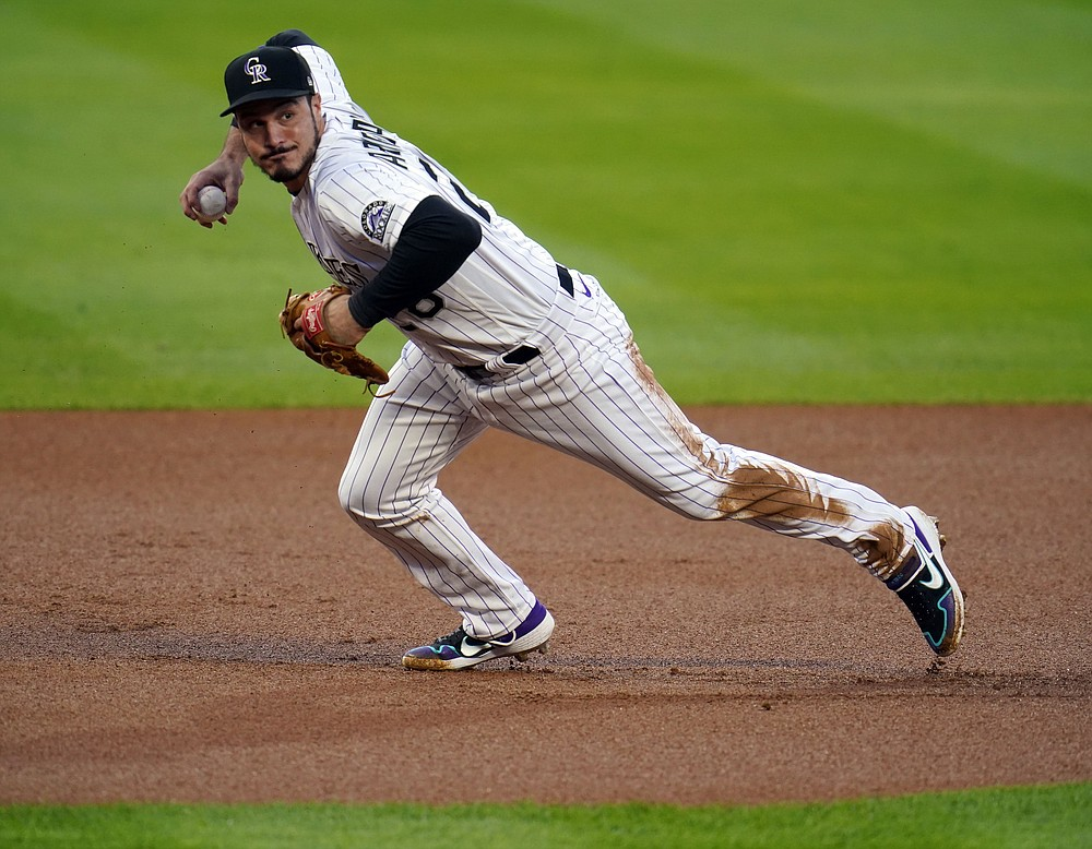 FILE - In this Sept. 11, 2020, file photo, Colorado Rockies third baseman Nolan Arenado throws to first during the first inning of a baseball game against the Los Angeles Angels in Denver. The St. Louis Cardinals finalized their blockbuster trade to acquire All-Star third baseman Arenado from the Rockies on Monday, Feb. 1, 2021. (AP Photo/David Zalubowski, File)