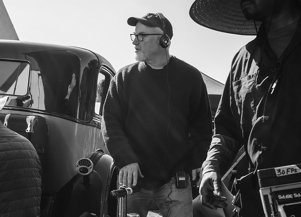 "This image released by Netflix shows David Fincher on the set of ""Mank."" Fincher was nominated for a Golden Globe for best director on Wednesday, Feb. 3, 2021 for his work on the film. (Gisele Schmidt/Netflix via AP)"