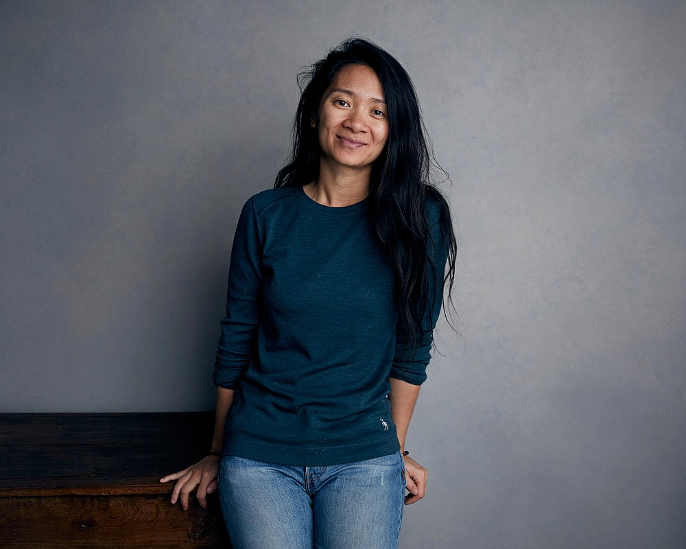 "FILE - Chloe Zhao poses for a portrait during the Sundance Film Festival in Park City, Utah on Jan. 22, 2018. Zhao was nominated for a Golden Globe for best director on Wednesday, Feb. 3, 2021 for her work on ""Nomadland.""  (Photo by Taylor Jewell/Invision/AP, File)"