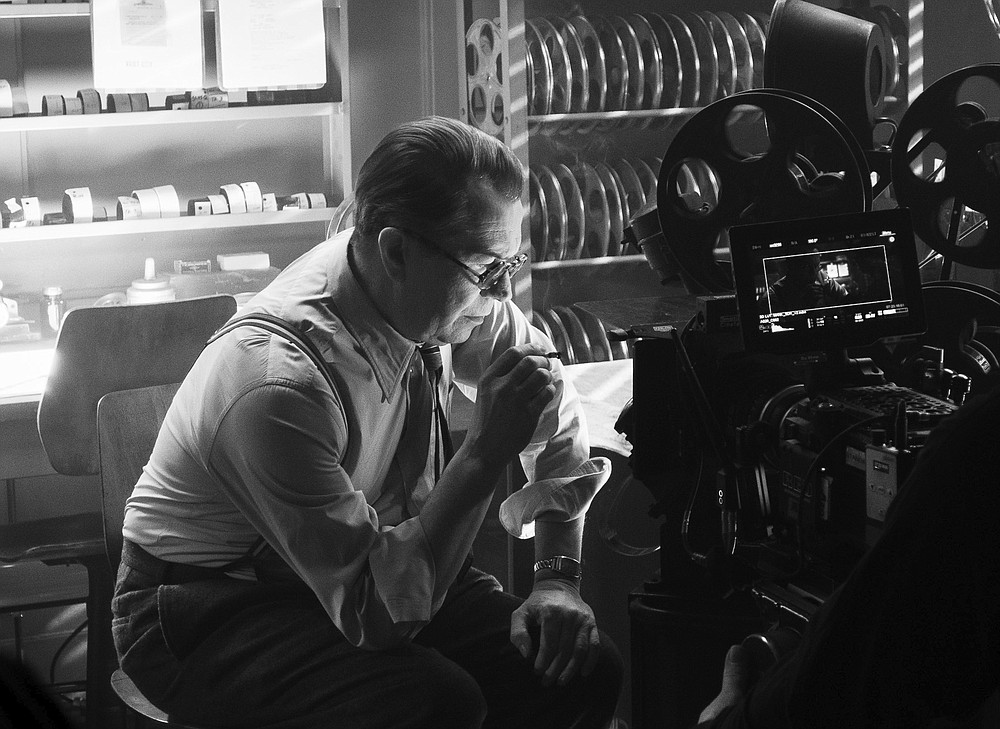 """In this image released by Netflix, Gary Oldman portrays Herman Mankiewicz in a scene from """"Mank."""" On Wednesday, Feb. 3, 2021 the film was nominated for a Golden Globe for best motion picture drama. (Nikolai Loveikis/Netflix via AP)"""