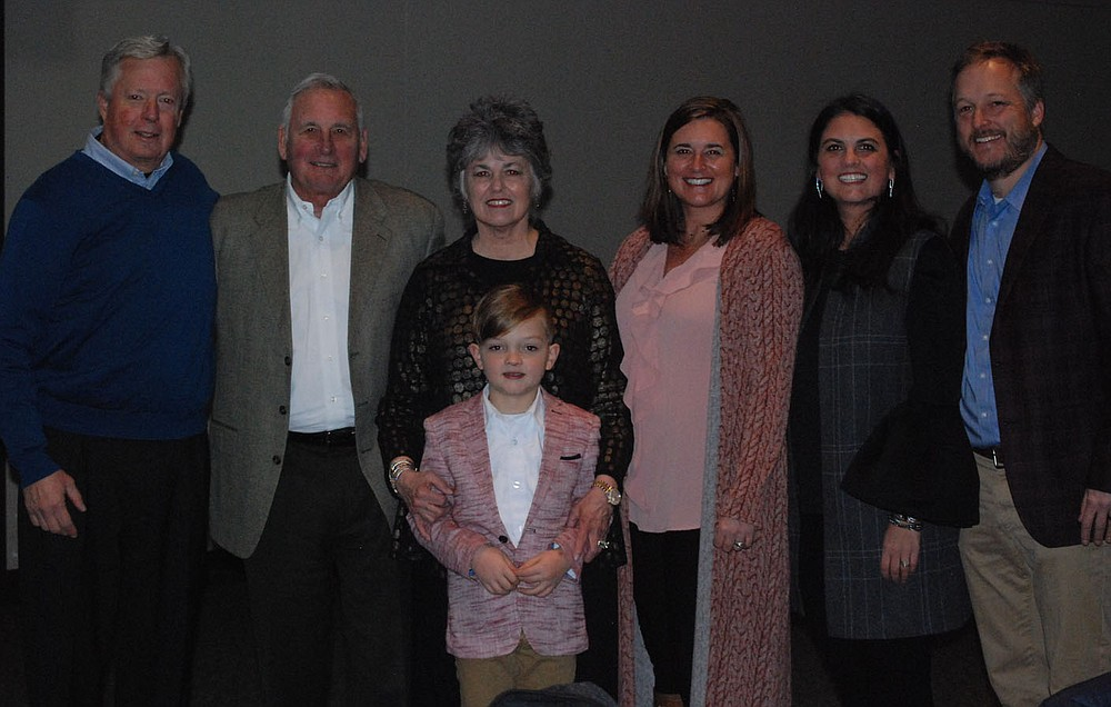 NWA Democrat-Gazette/JOCELYN MURPHY Jim Tucker (from left), Kirk and Cynthia Dupps, Jimmie Tucker, Holly Ertel and KC and Joe Tucker gather at the AFP luncheon Nov. 14. Kirk and Cynthia were presented this year's Outstanding Fundraising Volunteer award.