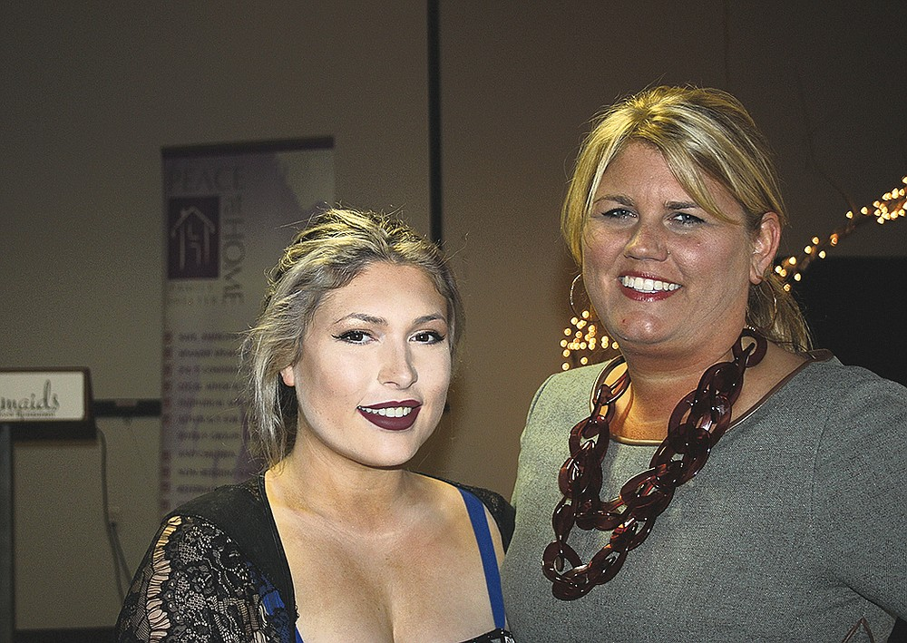 NWA Democrat-Gazette/CARIN SCHOPPMEYER Clancy Walker (left) and Mandy Macke help support Peace at Home at the Courage Award Luncheon on Oct. 23 at Mermaids Seafood Restaurant in Fayetteville.
