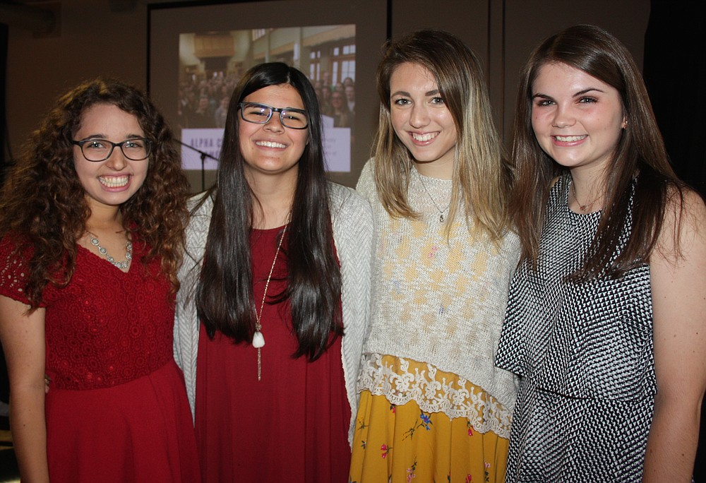 NWA Democrat-Gazette/CARIN SCHOPPMEYER Kianna Sarvestani (from left), Josie Bates, Julia Baird and Brooke Swilley, represent Courage Award honoree, Alpha Chi Omega, Delta Rho Chapter, at the Peace at Home benefit.