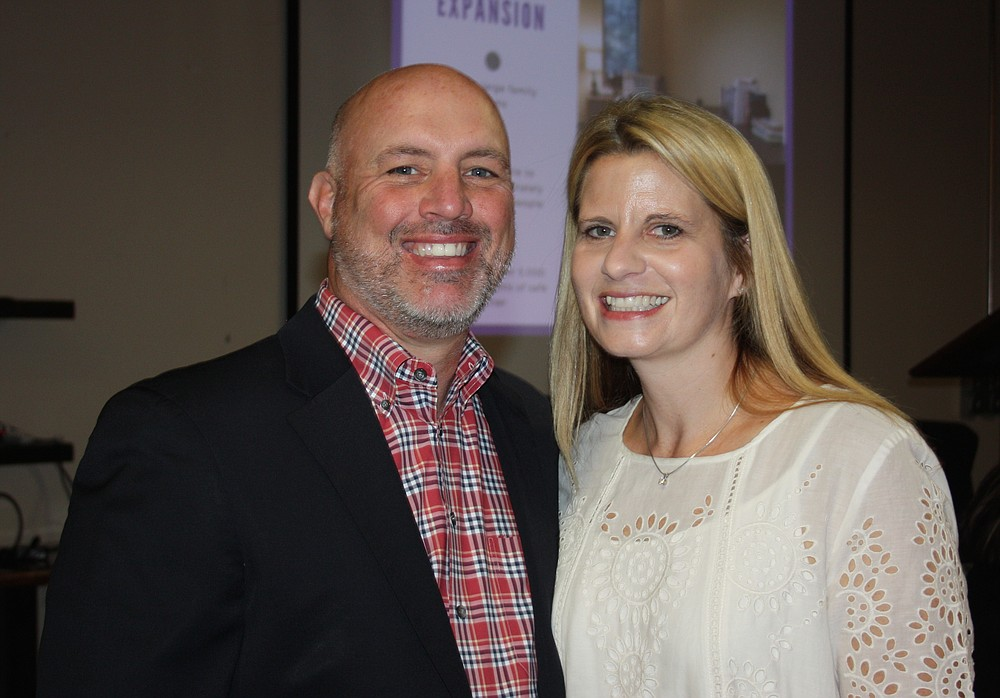 NWA Democrat-Gazette/CARIN SCHOPPMEYER Steve and Melissa Rogers, Courage Award honoree, enjoy the Peace at Home luncheon Oct. 20.