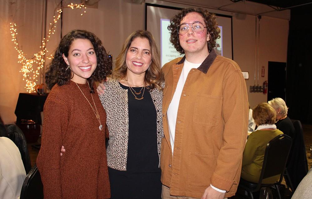 NWA Democrat-Gazette/CARIN SCHOPPMEYER Daniela Fernandez (center) is joined by her children Regina Capps and Diego Fernandez at the Courage Luncheon.